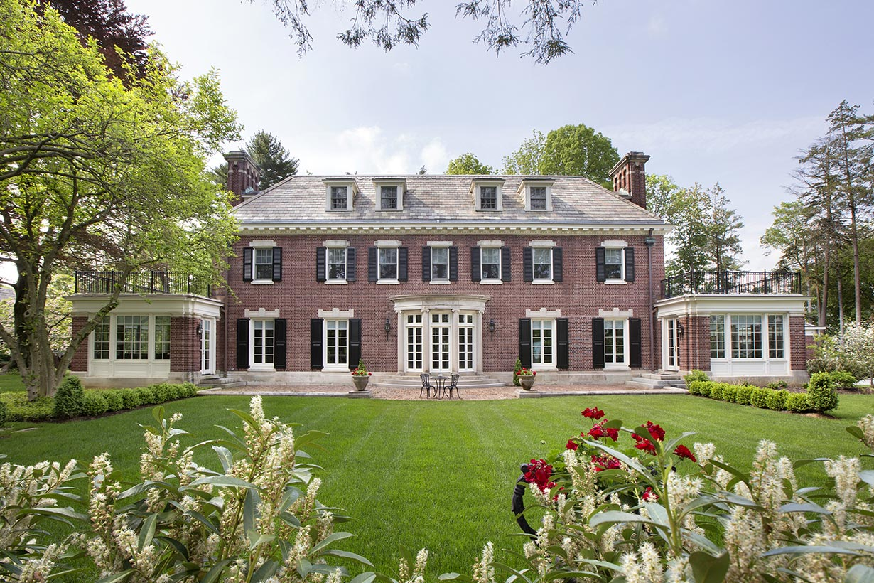 A two-story brick home representing the work of Architect Lasley Brahaney Architecture + Construction in Princeton, NJ