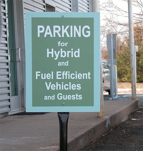 A shift in mentality: Lasley Brahaney provides special parking for those who use fuelefficient vehicles.