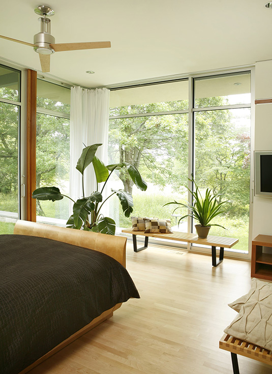 Summer Cooldowns for Steamy Bedrooms: Add some indoor plants.