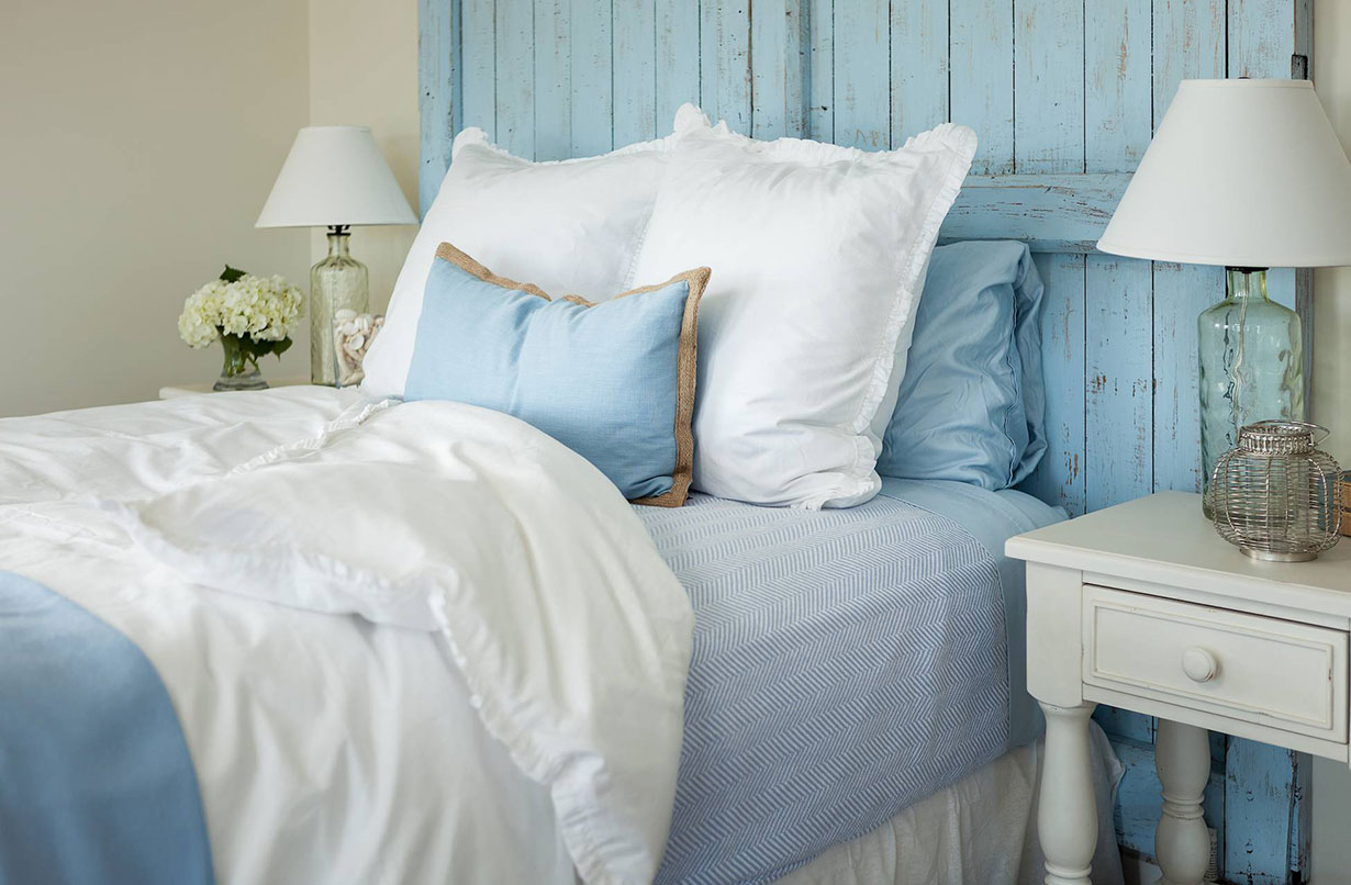 Summer Cooldowns for Steamy Bedrooms: Choose lightweight bedding.