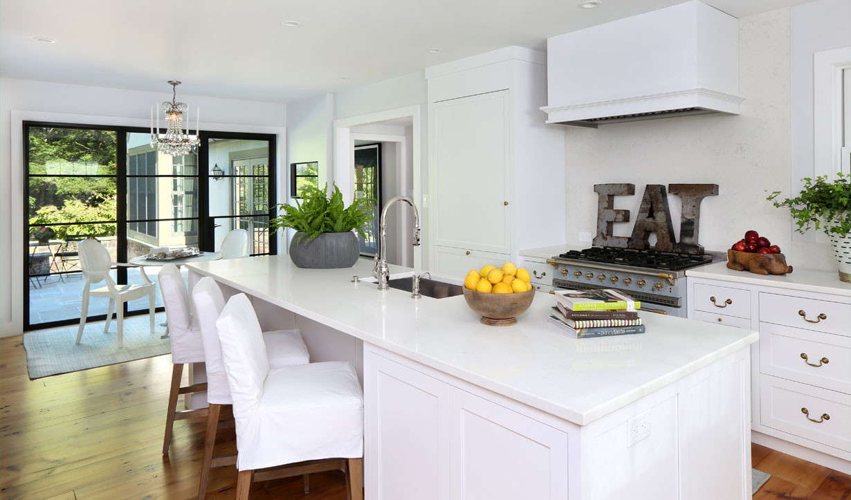 White, modern kitchen designed by construction company Lasley Brahaney Architecture + Construction in Princeton, NJ