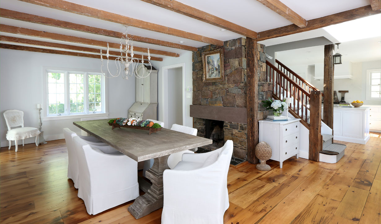 Kitchen with exposed beams designed by building company Lasley Brahaney Architecture + Construction in Princeton, NJ