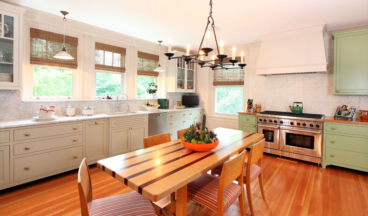 Kitchen with green and white cabinets redesigned by construction company Lasley Brahaney Architecture + Construction in Princeton, NJ