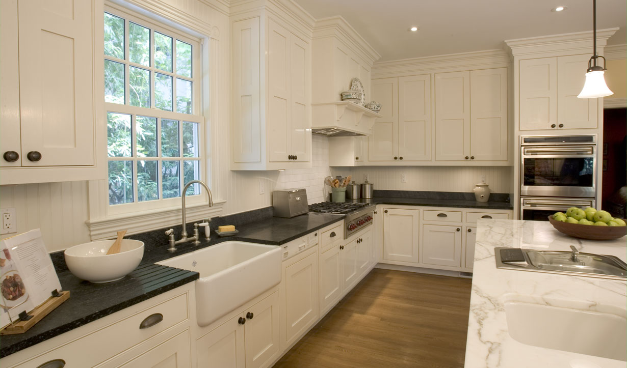 Spacious white kitchen redesigned by building company Lasley Brahaney Architecture + Construction in Princeton, NJ