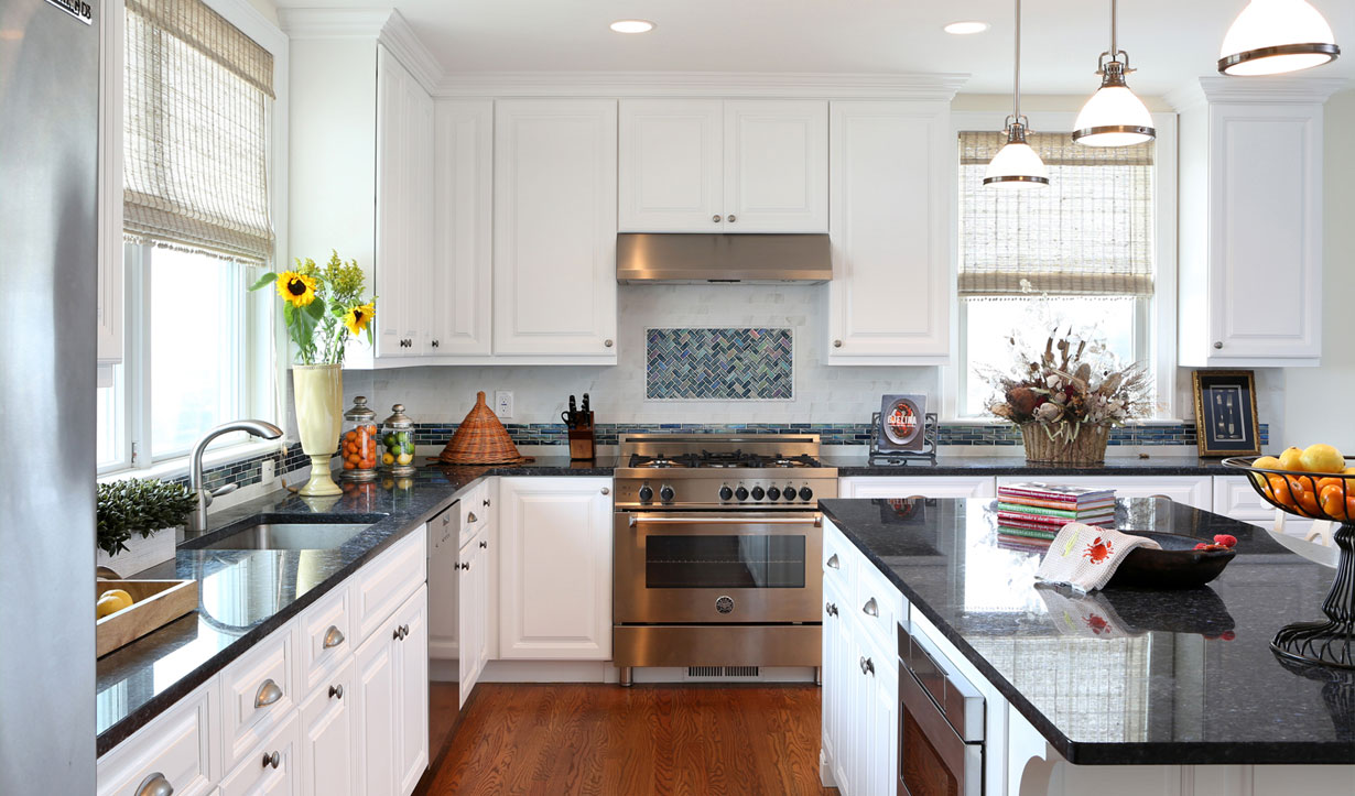 White and stainless steel kitchen design by construction company Lasley Brahaney Architecture + Construction in Princeton, NJ