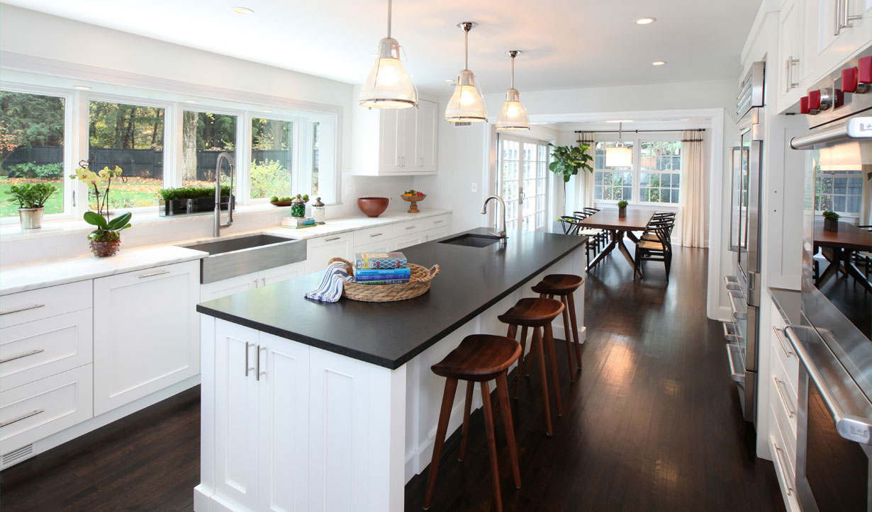 A white kitchen designed by construction company Lasley Brahaney Architecture + Construction in Princeton, NJ