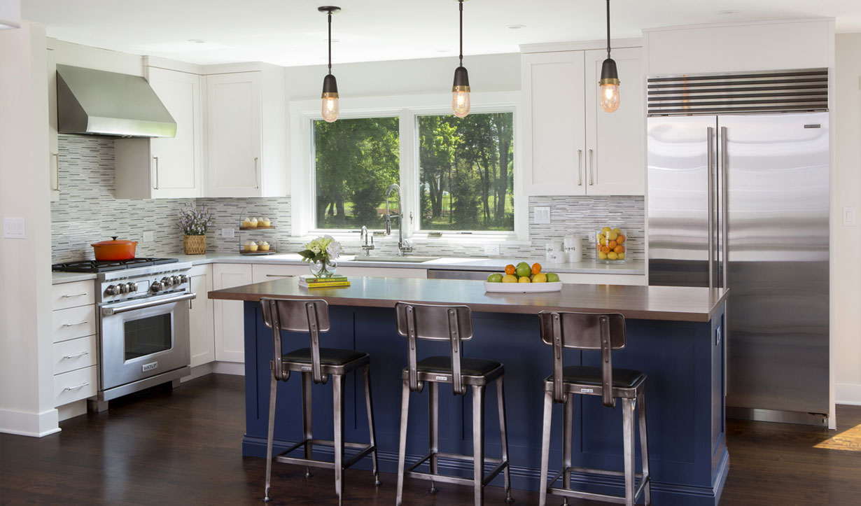 Navy blue kitchen island designed by building company Lasley Brahaney Architecture + Construction in Princeton, NJ