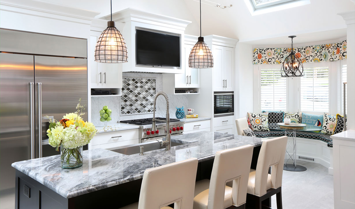 Marble and black kitchen renovation by construction company Lasley Brahaney Architecture + Construction in Princeton, NJ